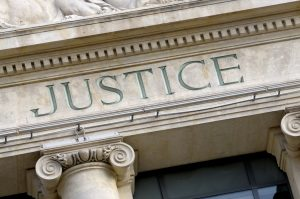 37291493 - justice sign on a law courts building